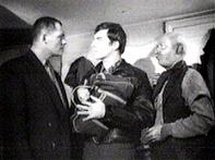 Robert Shaw, Alan Bates, and Donald Pleasence fighting over a handbag