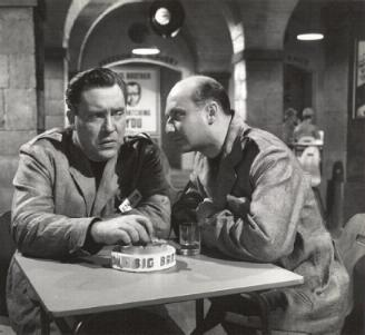 O'Brien and Pleasence drink at the canteen