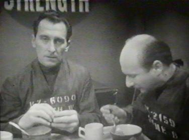 Peter Cushing and Donald Pleasence eating stew at the canteen